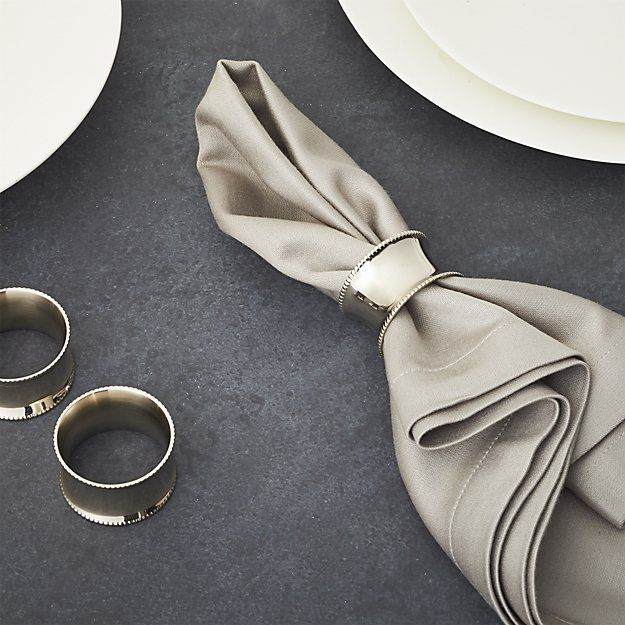 Tastefully traditional napkin ring crafted in brass with a silver nickel-plated and charming beaded rims adds elegant shine to table settings.