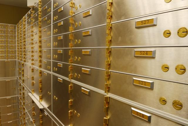 Safety Deposit Boxes Hold your Documents and Valuables: A wall of safety deposit boxes