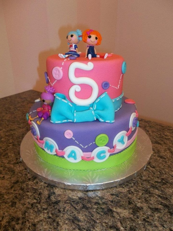 Lalaloopsy cake Oh, I know a little girl turning 5 this year that would love something like this!