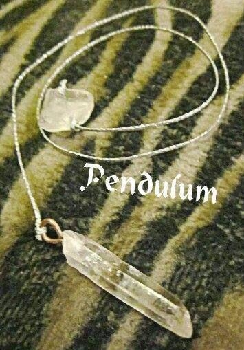 An excellent pendulum with clear, total transparent quartzes.The main quartz is a fine quality one.  Adorable pendulum for purification!!!
