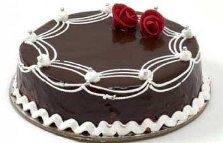 Chocoladetaart recept met biscuit, chocolademousse en glazuur van chocolade
