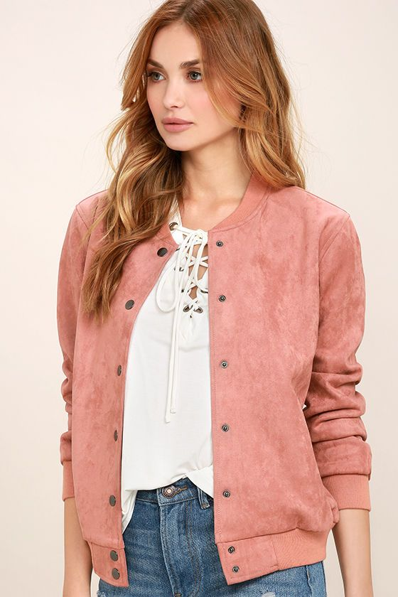 The Home Run Blush Pink Suede Varsity Jacket is a winner in our book! Trendy faux suede creates a luxe look over long sleeves, and the relaxed bodice with a full snap button placket, and vertical welted pockets. Ribbed knit collar, cuffs, and hem. As Seen On Audrey-Anne of @audreyannej!