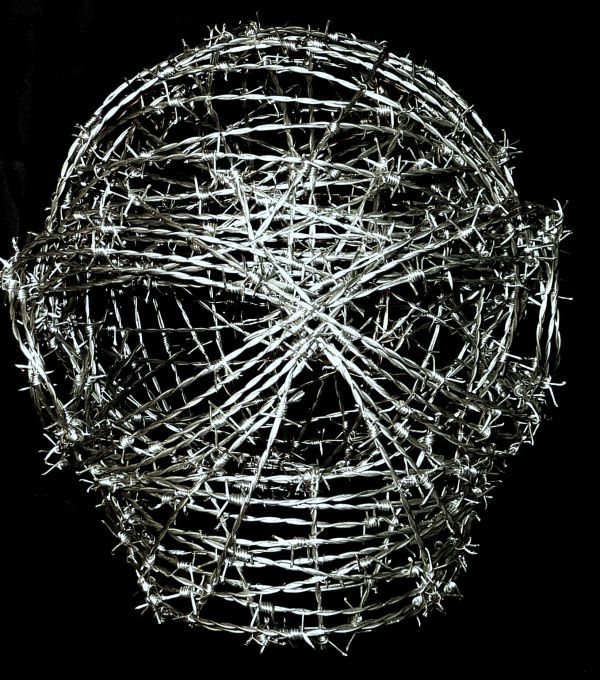 Barbed wire Wire(Mesh Netting Chicken) Metal Rod or Bar or Tube sculpture by sculptor Anthony Moman titled: 'Painful Existence (Large Barbed Wire Face Mask sculptures)'
