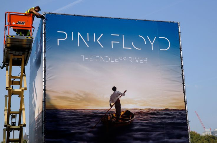 """Advertising for the new Pink Floyd album """"The Endless River"""" is installed on a four sided billboard on the South Bank in London."""