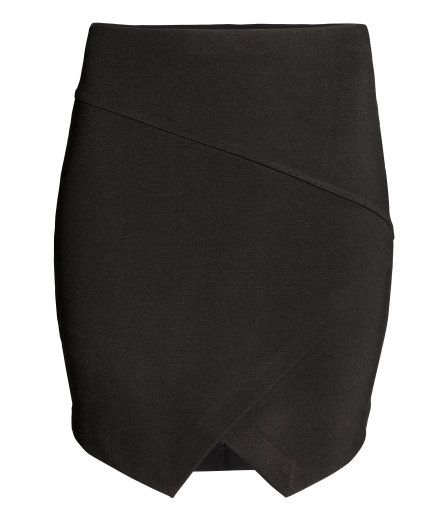 Check this out! Short fitted skirt in sturdy jersey with concealed elastication at the waist, a wrapover front and asymmetric hem. Unlined. - Visit hm.com to see more.