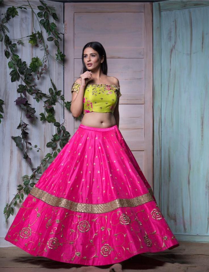Stunning pink color designer lehenga with parrot green color off shoulder designer blouse.