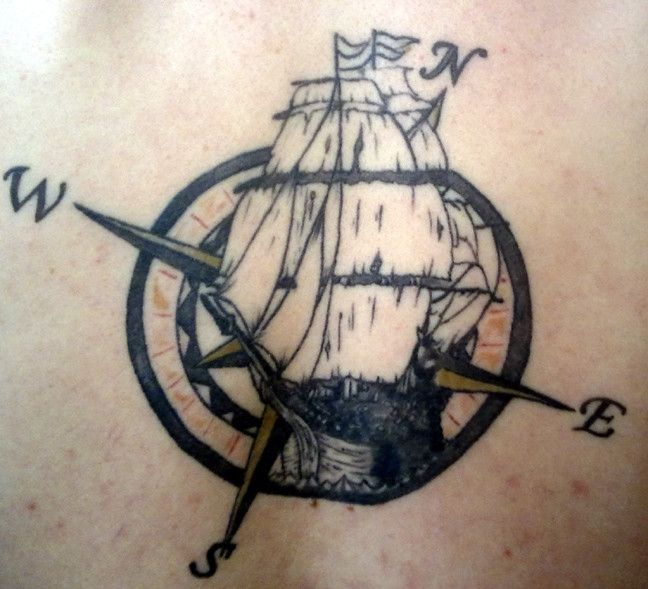 Compass and ship tattoo