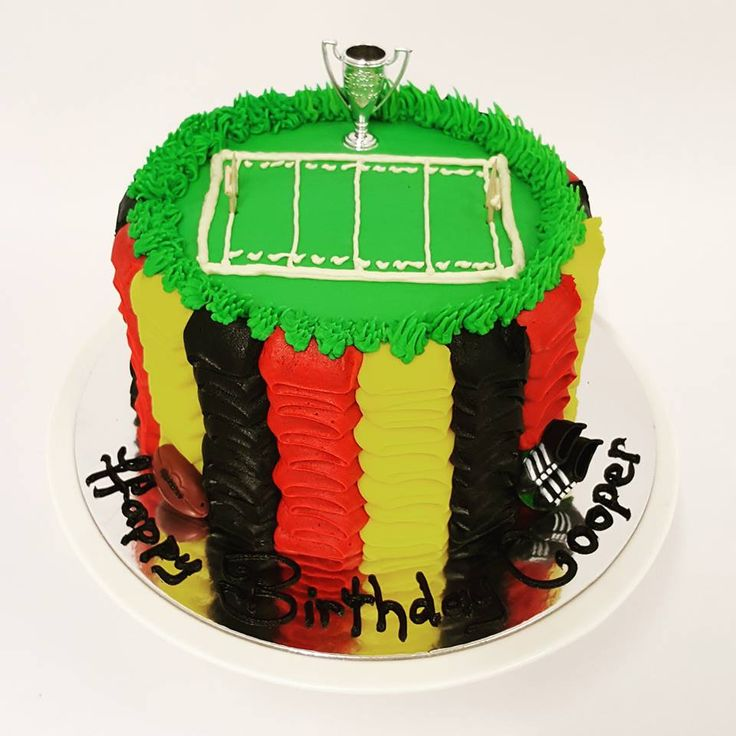 Red, Yellow and Black Ruffle cake with Rugby Field
