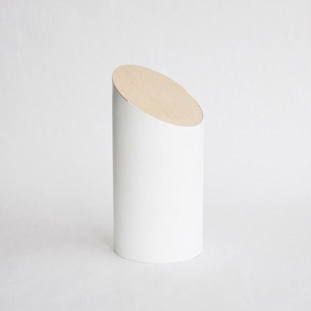 This beautiful minimalist bin, designed by Japanese designer Shigeichiro Takeuchi, consists of nothing more than a cylindrical body and a wooden lid – but no moving parts added.