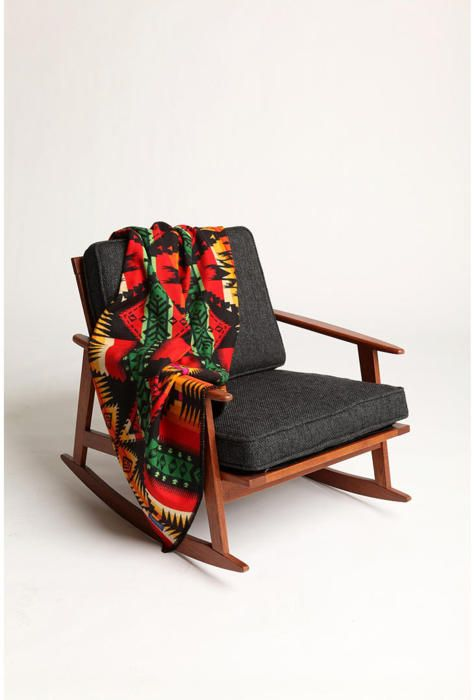 i could spend a lifetime in a lovely chair with a pendleton throw