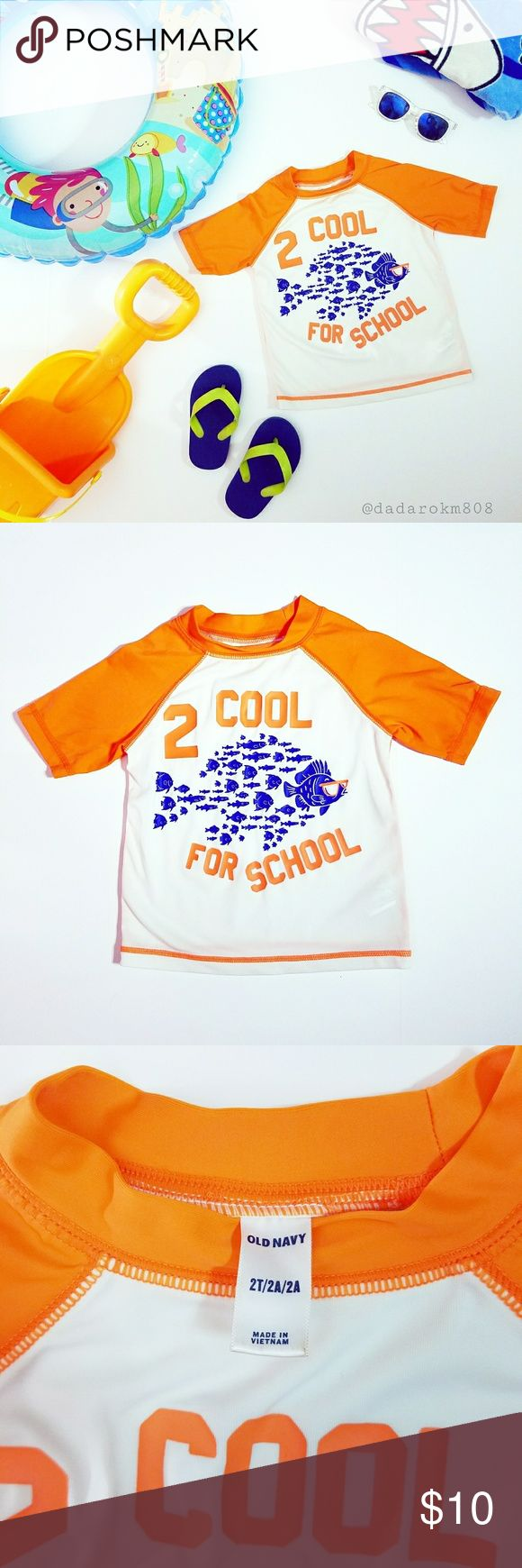 "Old Navy 2 Cool For School Rash Guard (size 2T) No caption needed! Your little tyke will definitely stand out from the rest of the school of fish, in this cute little swim top! 🐟 2 Cool For School 🐟, for sure lol! Gently used and in good condition. Measurements: overall length is 13.5"" long, 11"" across chest, arms are approx. 7.5"" in length. Much Mahalo for checking it out! Offers welcomed as always 😉🤙🏼 Old Navy Swim Rashguards"