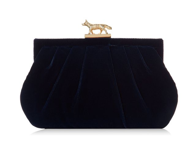 A gorgeous Lily Navy evening clutch bag from Wilbur & Gussie. This bag has been beautifully designed with a navy blue velvet fabric. Bag has a polished solid brass Fox clasp, optional gold chain and a inner pocket. View more bags from our Wilbur & Gussie Collection at: http://www.baroqueboutique.co.uk/wedding-shoes-and-accessories/