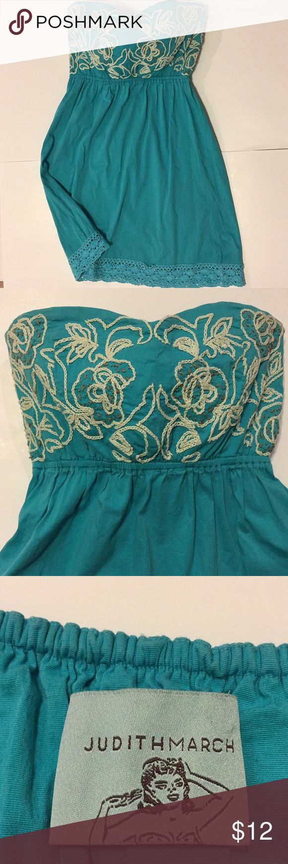 "Judith March Teal Strapless Sundress Judith March Teal embroidered strapless sundress.  This dress has been previously loved but is in decent condition. There are two flaws, pictured: (1) the crocheted trim on the hem has a small hole that has unattached from the hem.  (2) tiny stain on the white embroidery on top of dress. Can't really see it unless your looking for it.  The dress size is missing. I believe it to be a size Small Approx measurements are: Chest: 14.5"" Length: 25"" Please ask…"
