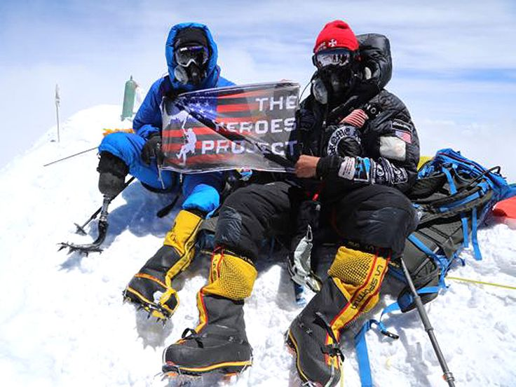"""""""It took them 9 hours, reaching the summit at 12:30pm and changing USMC SSGT Charlie Linville's life and hopefully inspiring more injured veterans to overcome their injuries from the war,"""" Zach Rosenfield, a spokesperson for The Heroes Project, the organization that led the climb, said in a statement."""