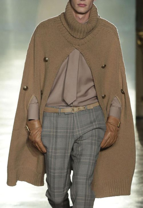 Men's camel turtleneck cape with plaid pants and monochromatic shirt and tie.