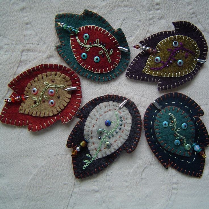 Felt leaves with added beads as a stickpin brooch