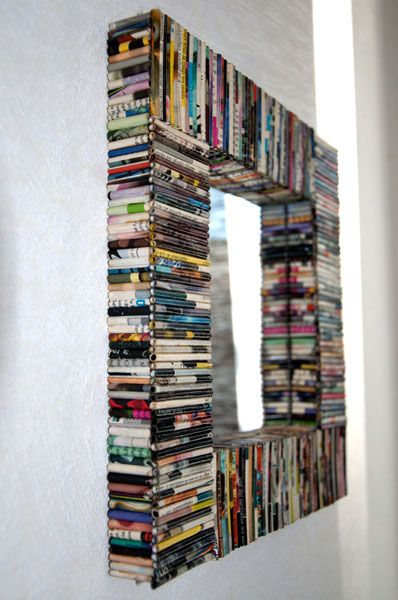 Really cool mirror made with old magazines, etc. wonder if it would work with old CD cases?!