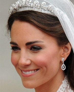 Kate Middleton's wedding day makeup: Bobbi Brown products used- Eyeshadows in Ivory, Rock Star, and Slate. Pale Pink blusher and Pink Shimmer Brick. Sandwash Pink lipstick with Crystal gloss! Total Cost: $133 dollars- Someone needs to get me a Gift Card ASAP!