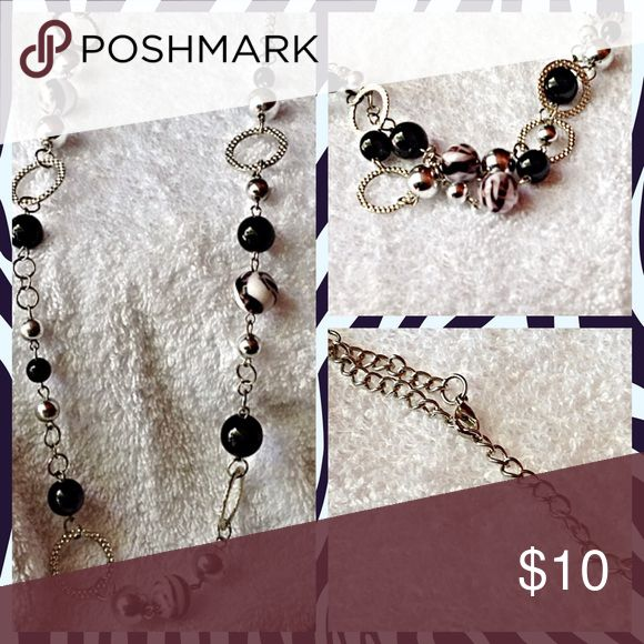 """Long beaded necklace 34"""" long beaded necklace. With zebra print bead. And silver color bead ,black bead . Jewelry Necklaces"""