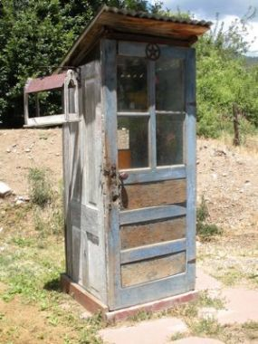 Garden outhouse. A hose in the back. Tools and pots inside. I love it!