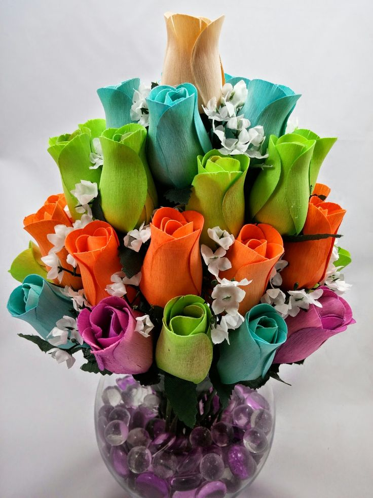 Create a vibrant centerpiece. Can be used to decorate any table, whether for an event or for display at home. Made with Birch Wood Roses that last forever. No need to water and they won't wilt. Engulfed in a glass vase, with optional Glass Beads to simulate water.