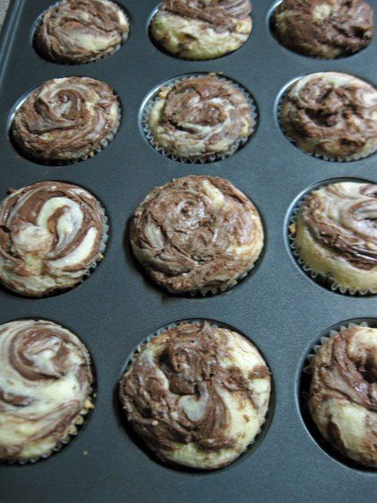 Delicious gluten free nutella muffins - like a cupcake with nutella but I feel better calling them muffins.