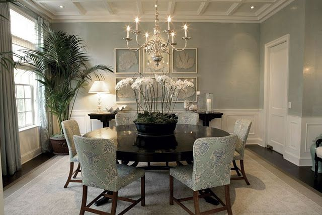 dining rooms - sea foam green dining table round coastal beach sea fans nickel chandelier chairs tonal palm orchids clam shell Asian console paneled