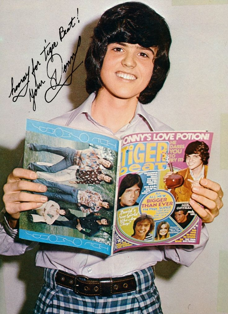 Donny reading Tiger Beat.Donny was my first crush still love him now.Please check out my website thanks. www.photopix.co.nz