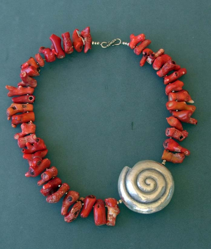 Coral Necklace with 41 coral parts and a big silver shell.