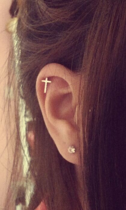 Cross cartilage earring.