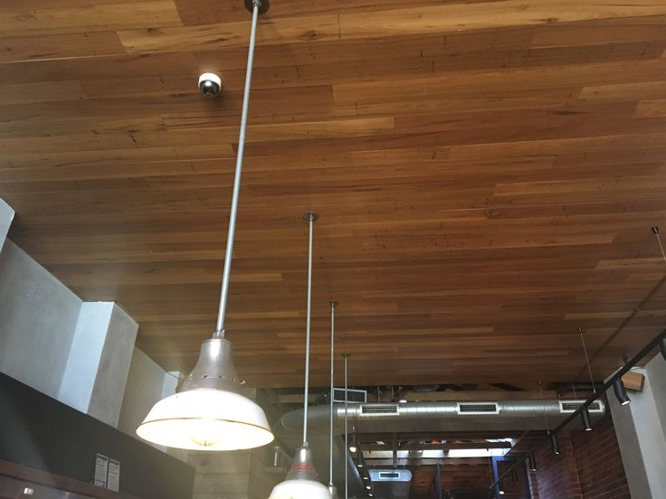 Timber flooring has been used to line the ceiling of this cafe helping to create the sense of a lower ceiling level as well as absorbing some of the environmental noise.