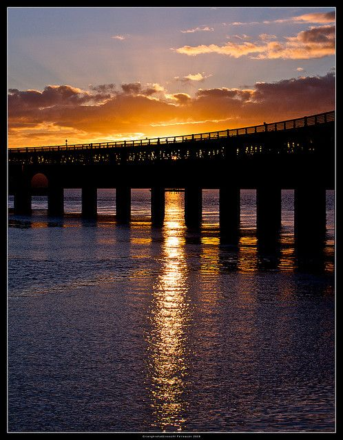 Tay Bridge Sunset, Dundee The Tay Bridge (sometimes unofficially the Tay Rail Bridge) is a railway bridge approximately two and a quarter miles (three and a half kilometres) long that spans the Firth of Tay in Scotland, between the city of Dundee and Wormit in Fife. #a4interactive