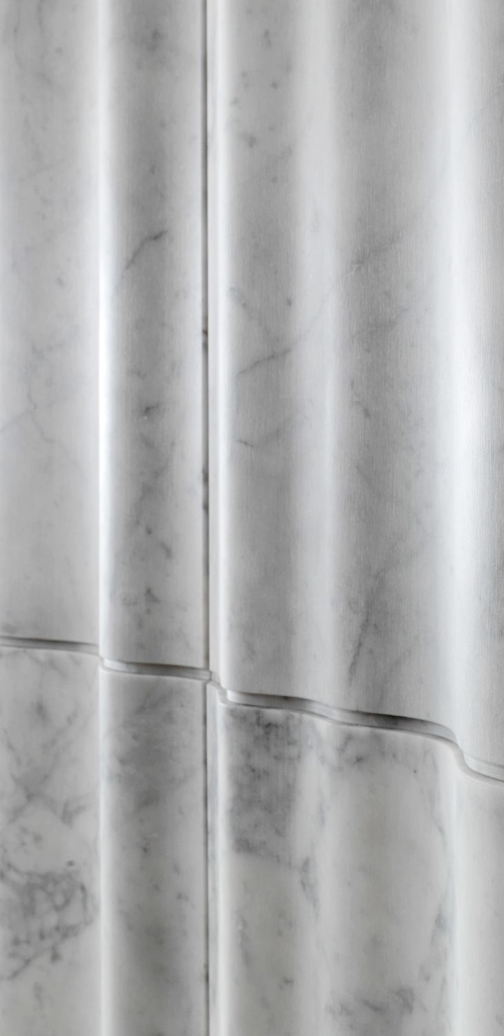 """As gauzy vertical draperies, the """"chiffon"""" 3d stone wall tiles give movement and depth to the wall thanks to the variety of their different-sized vertical folds. From the """"Drappi di Pietra"""" collection."""