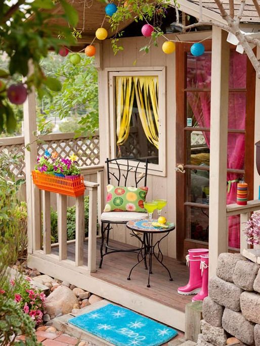 Sheds also make wonderful playhouses for children – include all the adult amenities like curtains, window boxes, and bistro sets for summer fun on a small scale. #porch