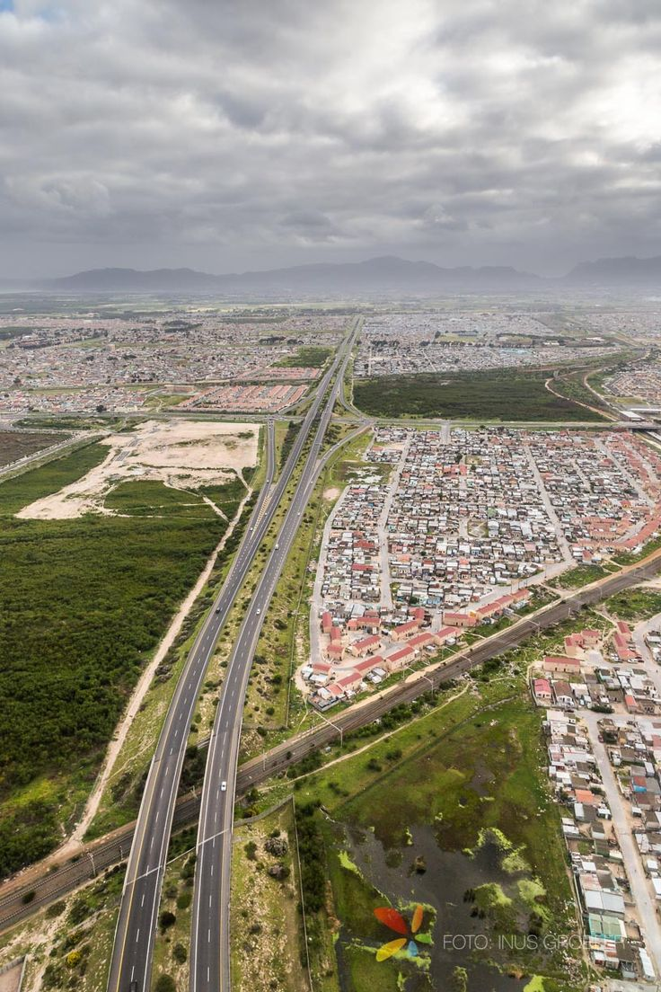 This aerial photograph was taken from an airplane flying over Cape Town. It ...