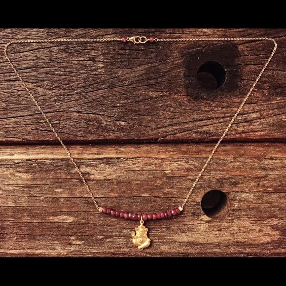 Ruby Necklace adorned w/ Ganesha NEPALI RUBIES WRAP GANESHA IN LOVE.  Wear this amulet to ensure success in love, relationships and business. Ganesha is the REMOVER of all Obstacles.  MATERIALS: GANESHA: 22K GOLD VERMEIL PRECIOUS STONES: 3MM FACETED NEPALI RUBIES CHAIN: 14K 0.7MM GOLD FILL CLASP: 14K GOLD FILL LOBSTER CLAW Deserving Jewels Jewelry Necklaces