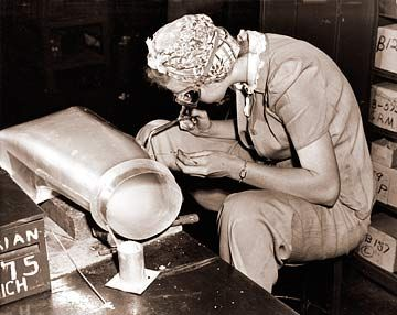 Woman doing a welding job in an airplane factory during WWII. #welding