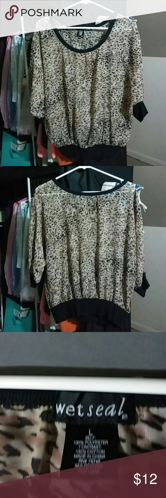 Wet seal leopard shirt Wet seal Leopard shirt  Size large Worn a couple times but in excellent condition Accepting offers Tops Blouses