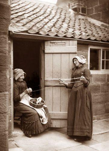 Frank Meadow Sutcliffe :  Two women winding wool.  Ref: E5