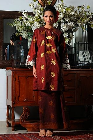 Baju Kurung, another national dress of Indonesia, mostly worn by Sumatran women.