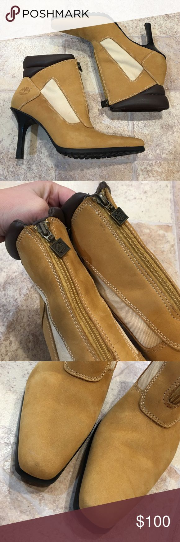   Timberland   Genuine Leather Heeled Boots In excellent condition. Only worn a few times. Some markings on the boots as shown in the pictures but not noticeable when wearing. One of a kind shoe! 100% authentic Timberland. Zips up in the front. Timberland Shoes Ankle Boots & Booties