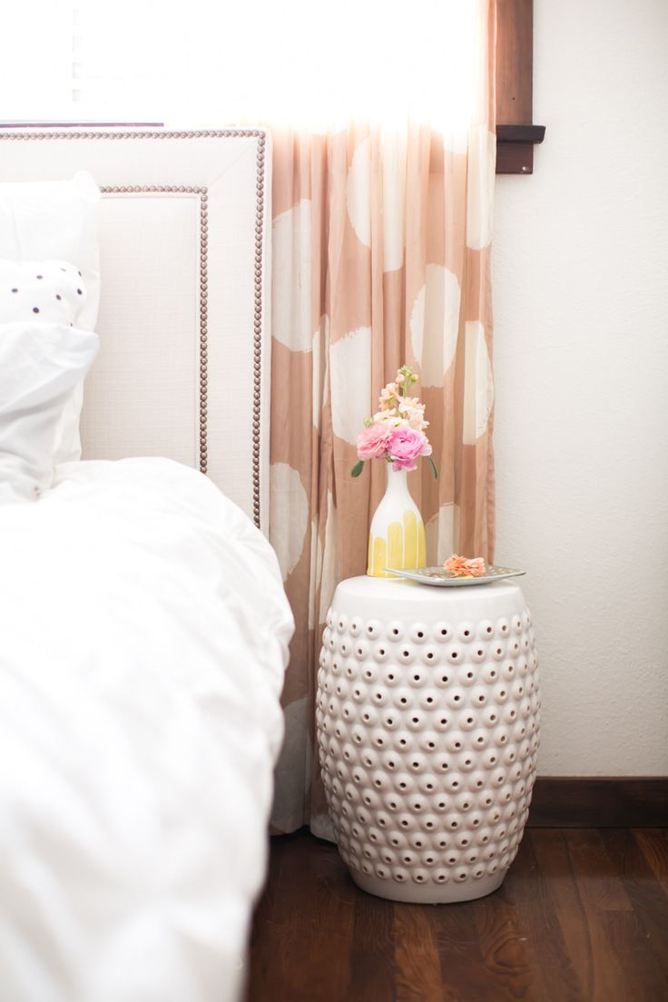White bedroom with polka dot curtains