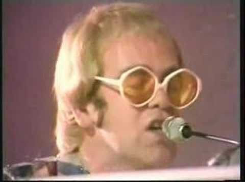 "Elton John-Crocodile Rock  For ""Waiting at the bus stop"" with my big bro ROBB when we were kids singing at the top of our lungs!"