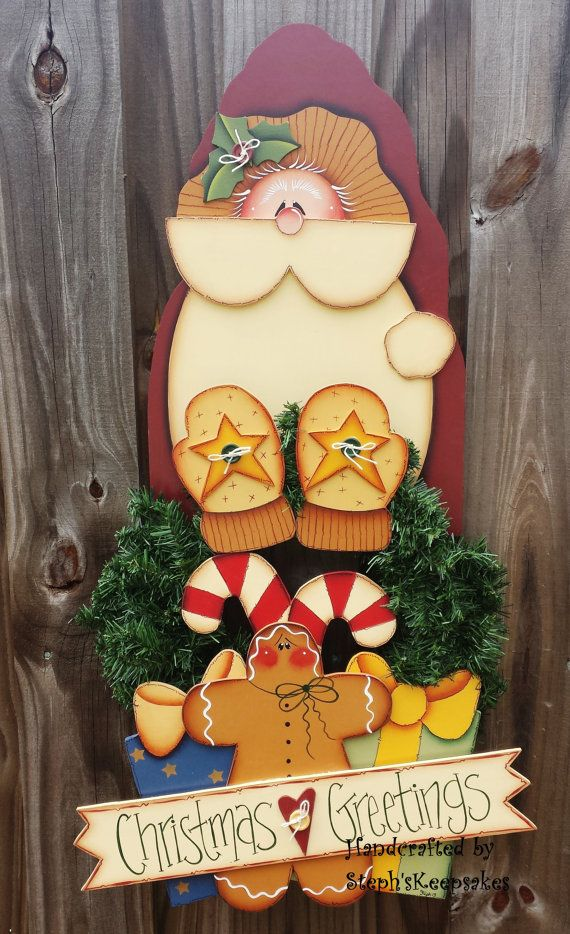Brigth your door with this beautifull Santa and all his gifts!!! he is great to add to your Christmas collectibles!  to He is coated to be used