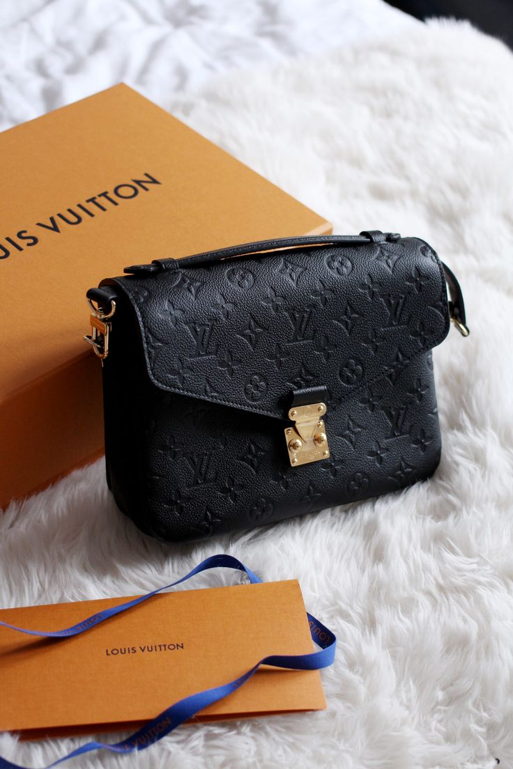 Louis Vuitton Pochette Metis in black monogram empreinte leather with gold hardware