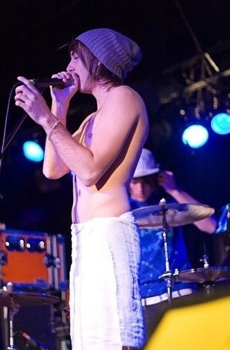 Alex, the only person who would go on stage in just a towel and a beanie...