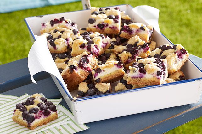 Yellow cake and cream cheese join with lemon zest and fresh blueberries to make moist, fruity crumb bars.