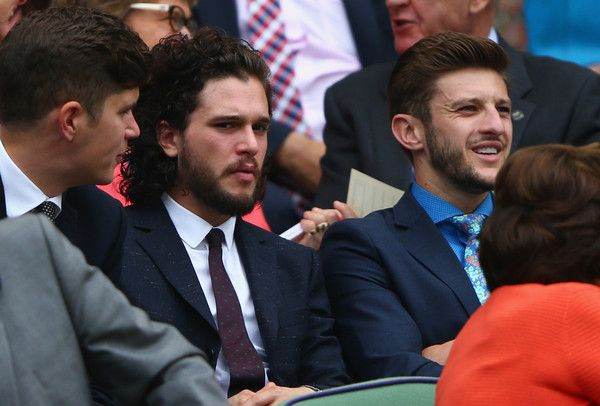 Kit Harington Photos Photos - Actor Kit Harington (L) and Liverpool and England footballer Adam Lallana look on from Centre Court during day four of the Wimbledon Lawn Tennis Championships at the All England Lawn Tennis and Croquet Club on July 2, 2015 in London, England. - Day Four: The Championships - Wimbledon 2015