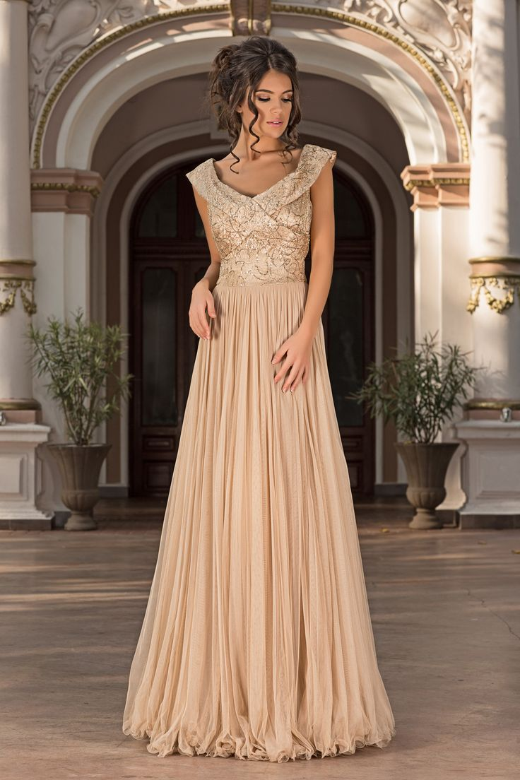 Figure-flattering style reigns supreme on this softly romantic Vero Milano gown.The delicately ruched surplice bodice culminates in a romantic low-V neckline. Long lengths of impossibly fine material sweep to the floor on the skirt.