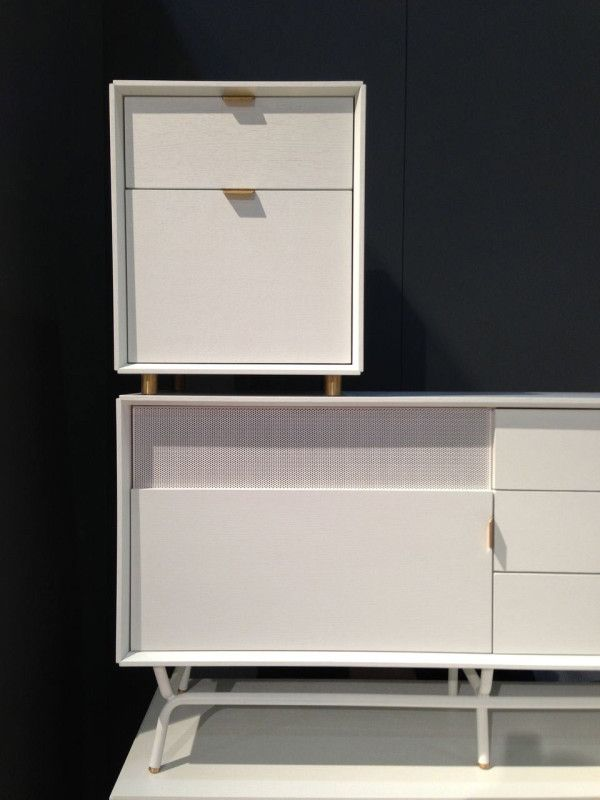 Blu Dot's Dang collection of mid-century inspired consoles include panels with tiny holes so that your remote controls can still work without your entertainment devices having to be on display. They also have matching 2-drawer units for files.